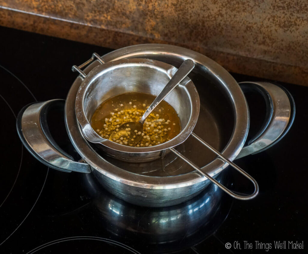 Oils and emulsifying wax in a double boiler