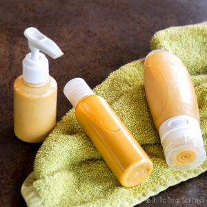 3 different bottles of a homemade body shimmer oil