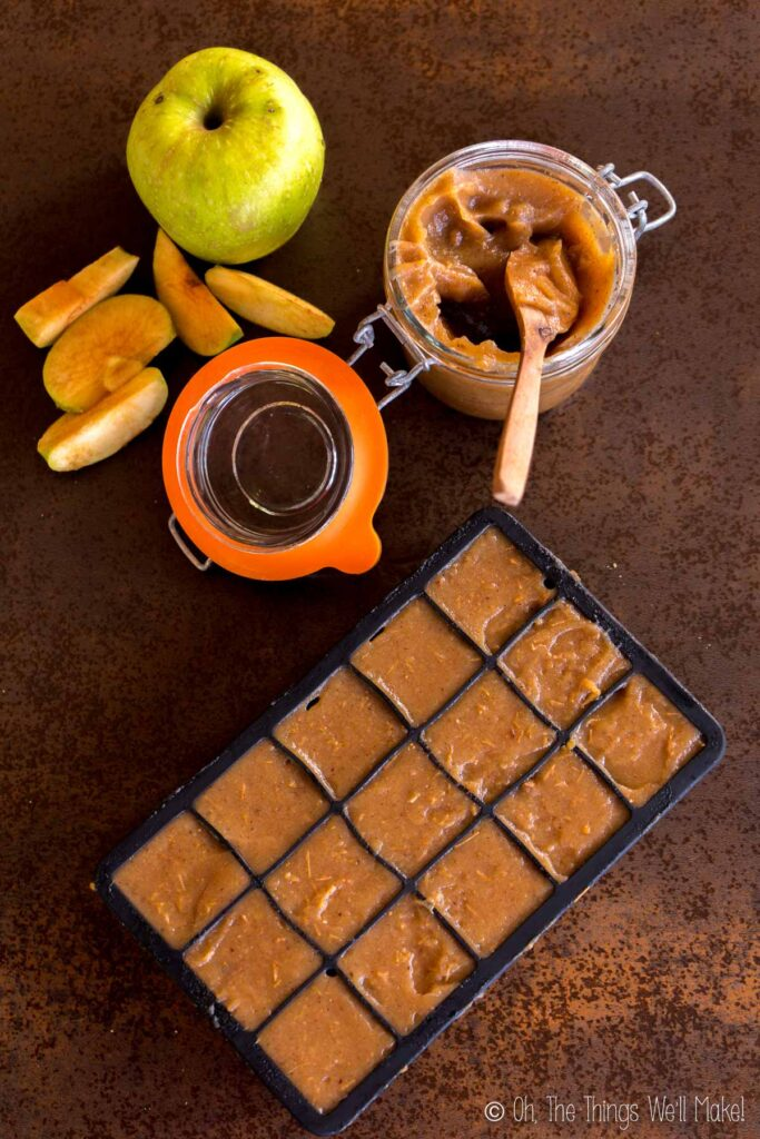 Overhead view of apple butter in a jar and in an ice cube tray