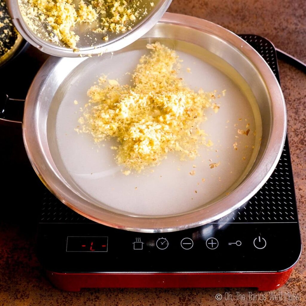 Adding minced ginger to a pan with sugar and water