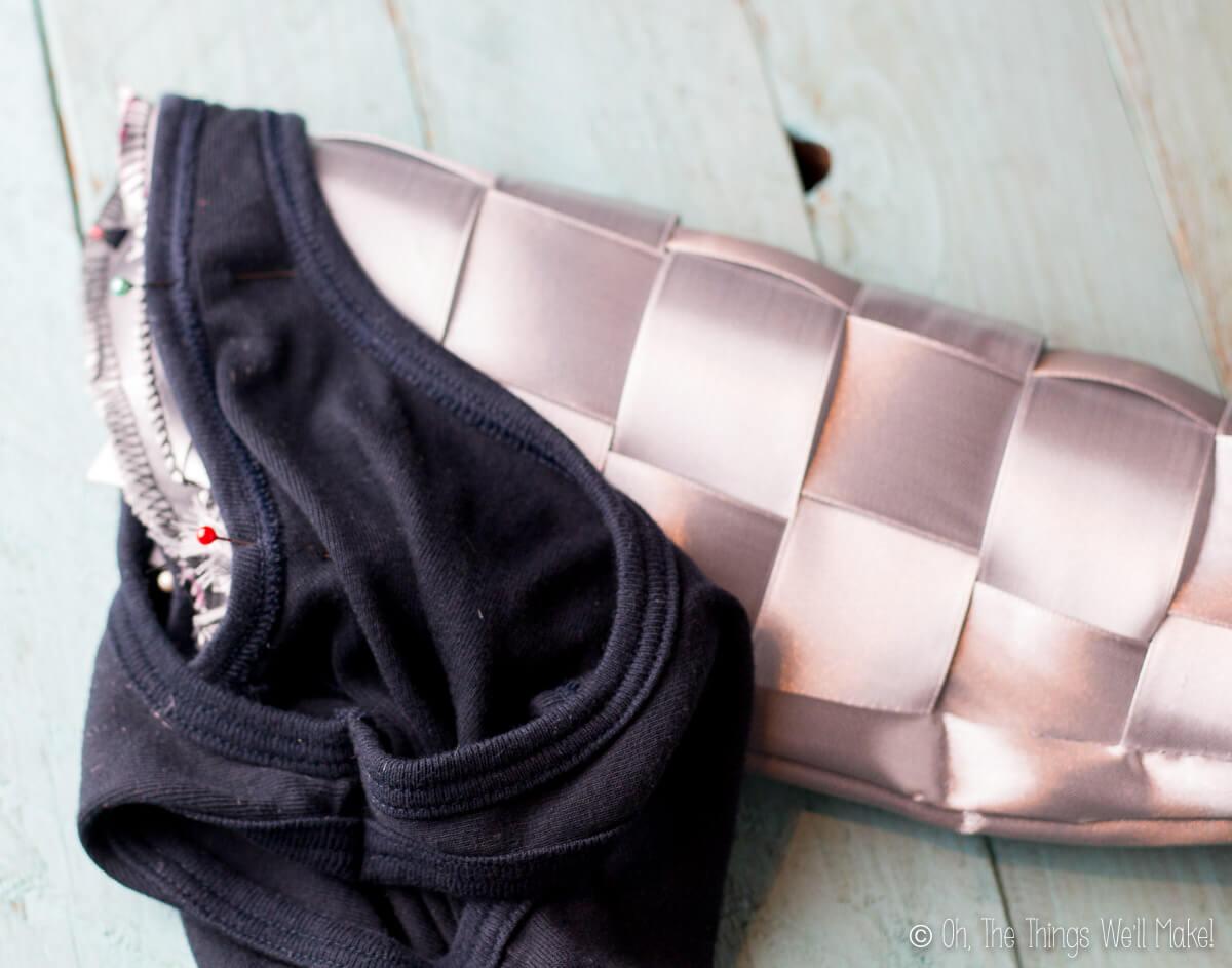 Ribbon sleeves sewn onto a black tank top